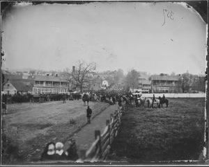 Regiment marching down a village street